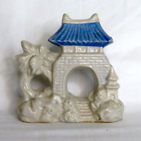 Grey and blue ceramic fish tank decoration shaped like a pagoda