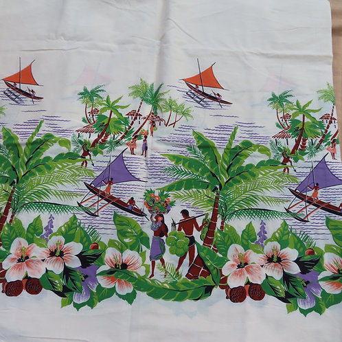 Vintage Hawaiian print fabric with a colorful tropical scene on an off-white background
