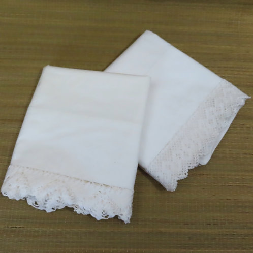Pair of vintage unmatched white pillowcases with crochet lace trim