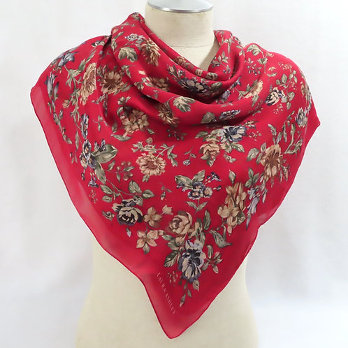 Large red floral print scarf draped on mannequin