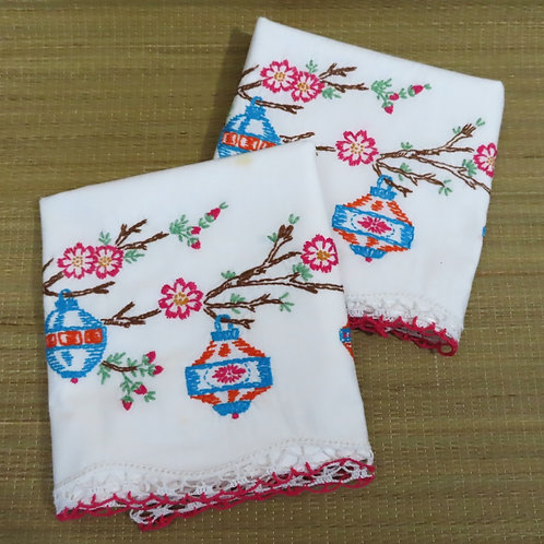 2 vintage white pillowcases with colorful Asian lantern embroidery motif