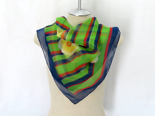 Blue and green striped and floral print scarf on mannequin