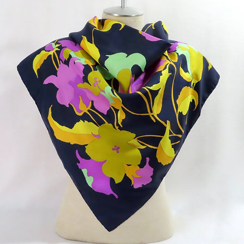 Dark blue floral Dior scarf shown draped on a mannequin