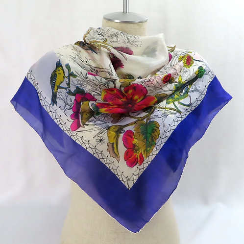 Scarf on mannequin with bird on flowers print and solid purple border