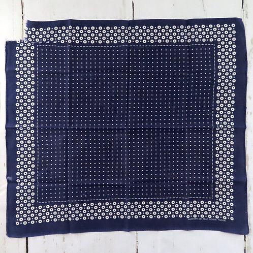 Vintage dark blue and white polka dot bandana with damage on one corner