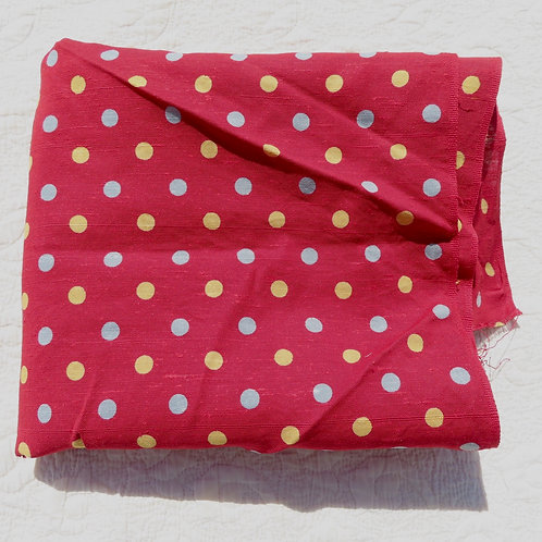 Red fabric with yellow and gray polka dots