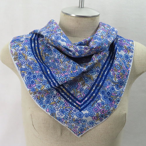 Blue floral print scarf on mannequin
