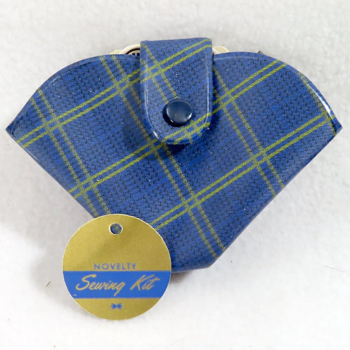 Blue plaid plastic folded triangle sewing kit for repairs