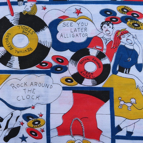 Vintage fabric with primary colored 50s rock and roll scenes
