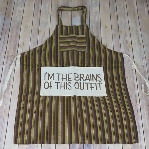 Brown striped apron has a white pocket with 'I'm the brains of this outfit' printed on it