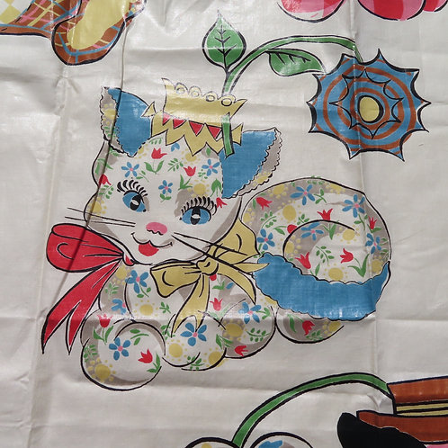 Fanciful colorful image of cat printed on chintz curtain fabric
