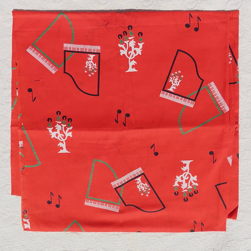 Bright red fabric with abstract pianos and music notes