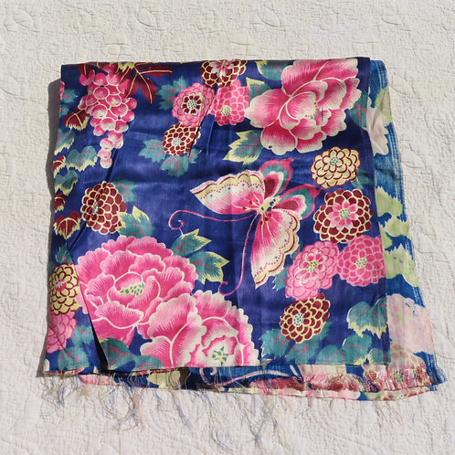 Antique blue fabric covered with pink butterflies and flowers