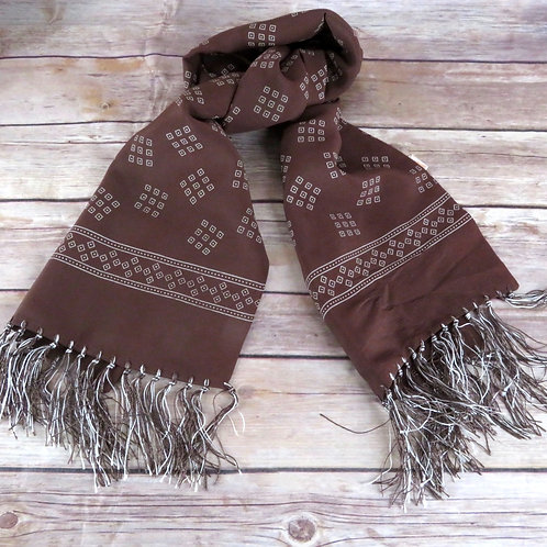 Vintage brown scarf laying on wooden table