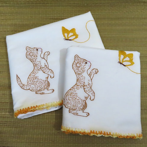 2 vintage embroidered pillowcases with motif of brown cat playing with yellow butterfly