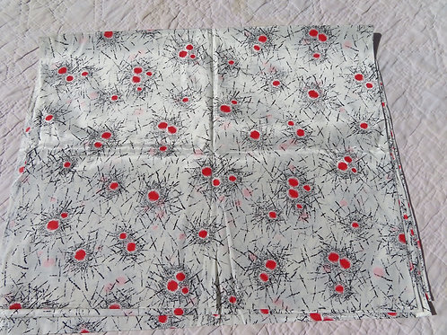 Shiny white vintage fabric with orange and black abstract print