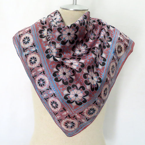 Block print silk scarf with allover floral pattern shown on mannequin