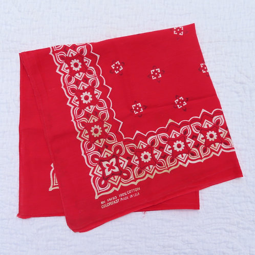 Folded vintage bandana with red and geometric floral border