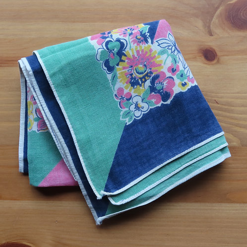 Folded scarf with blue, green and pink print