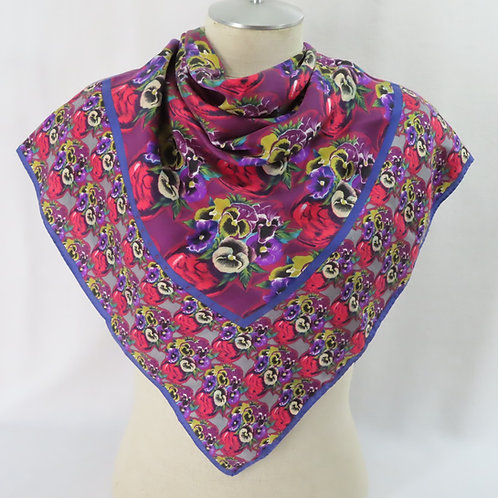 Colorful pansy print floral scarf shown draped on mannequin