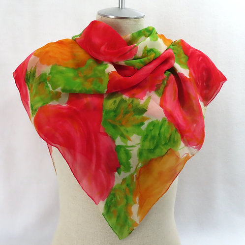 Pink green and orange rose print scarf on mannequin