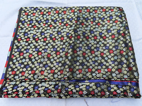 Vintage brocade fabric with small woven star-shaped flowers