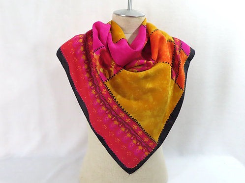 Bright pink, yellow and orange silk scarf on mannequin