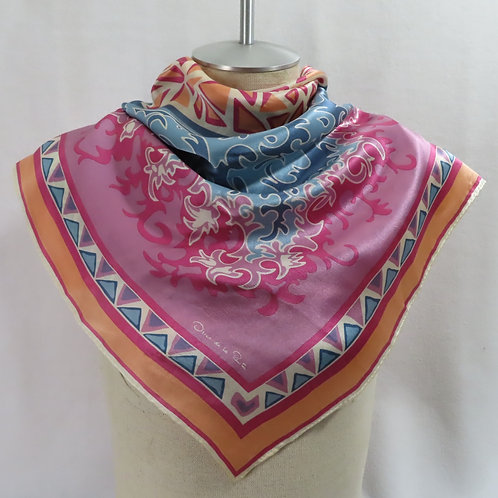 Purple, pink and blue silk scarf shown on mannequin