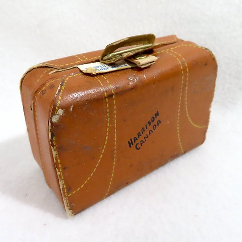 Vintage souvenir mending kit in small brown leather suitcase