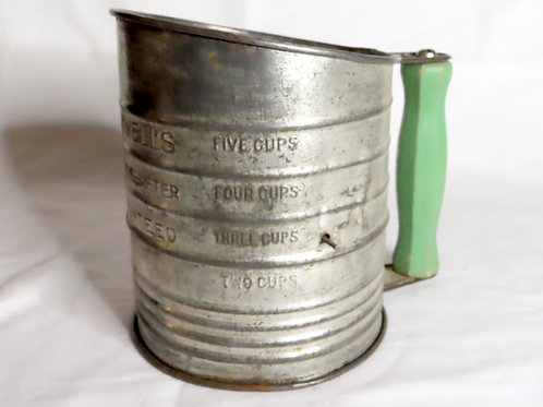 Vintage metal Bromwell's flour sifter with green wooden handle