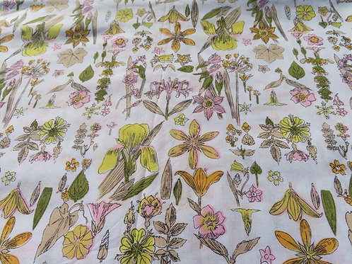 Pastel botanical print on white background fabric