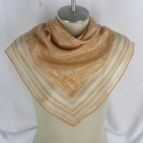 Peach Diane von Furstenberg scarf on mannequin