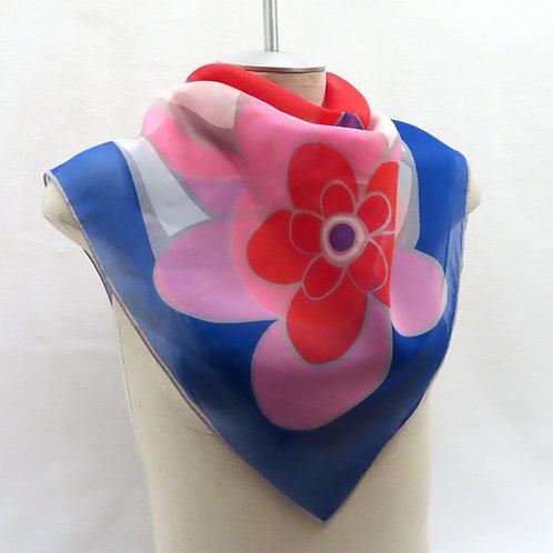 Mod pink red blue floral scarf on mannequin