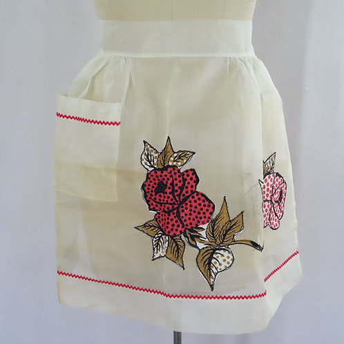 Vintage off white gathered waist style apron with flower applique at the front