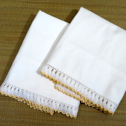 Pair of vintage white pillowcases with hand crochet yellow and white lace