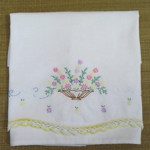 Vintage white cotton pillowcase with yellow crochet lace and embroidered flower basket
