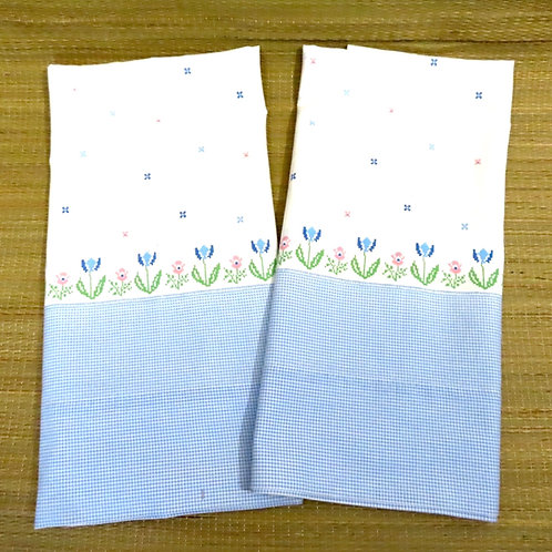 Blue and white check and floral print pillowcase pair