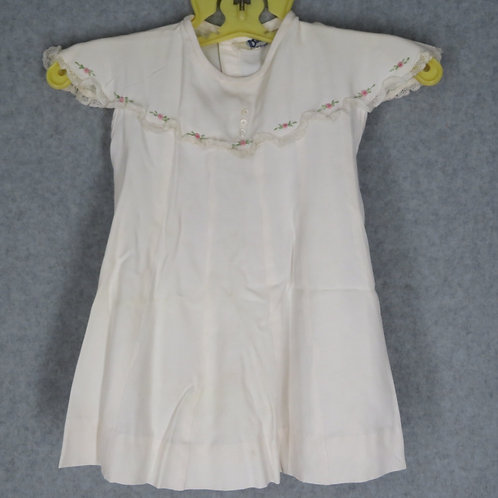 Ivory colored vintage 70s baby dress with embroidery