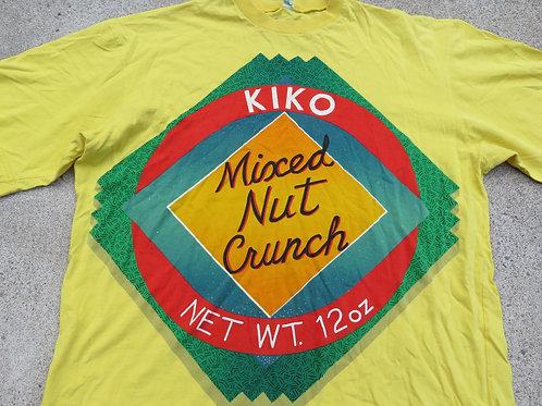 Bright yellow tee with a Kiko Mixed Nut Crunch logo