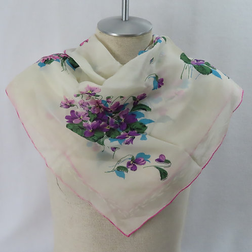White scarf with purple violets shown on mannequin
