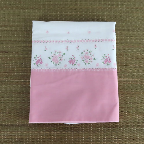 Vintage border print pillowcase is white with small flowers and a solid pink end