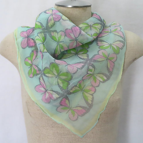 Vera butterfly print scarf on mannequin