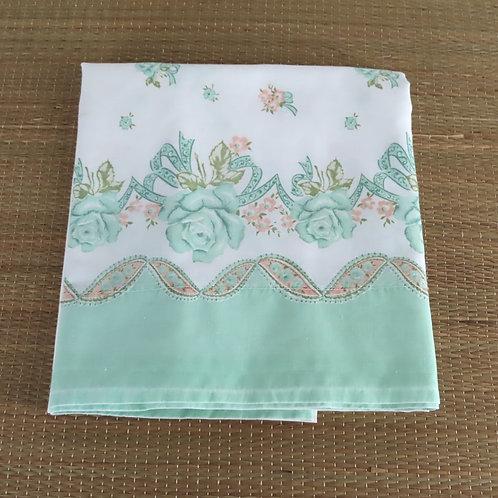 Vintage border print pillowcase in white with aqua green end