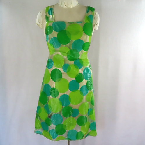 Vintage sheer plastic apron with large green polka dot allover print