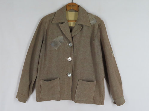 Vintage brown wool jacket that's visibly mended with patches