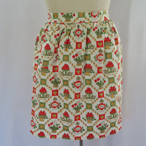 Vintage gathered waist half apron with allover kitchen print and the words JAM