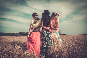 Multi-ethnic hippie girls  in a wheat fi
