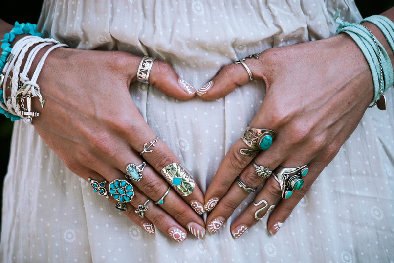 closeup of young woman hands in heart sh