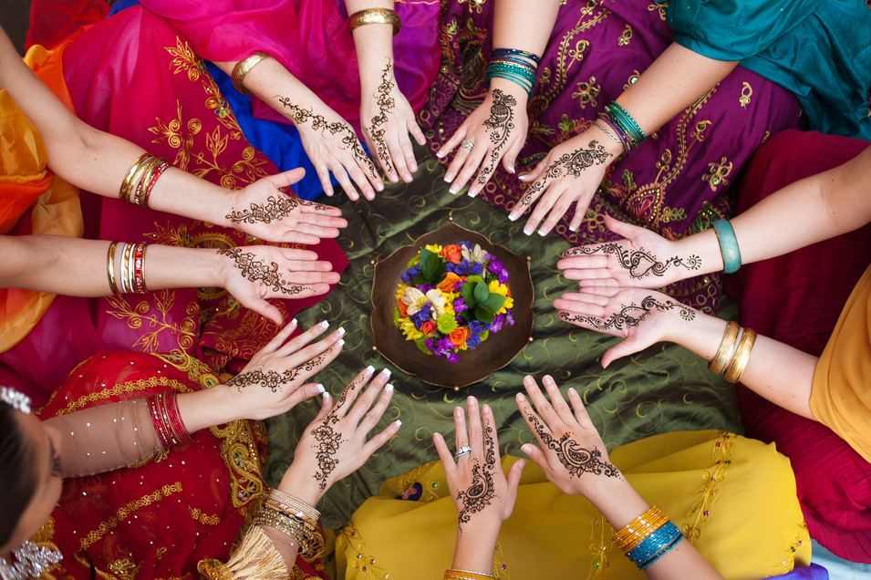 Six pairs of henna decorated female hand