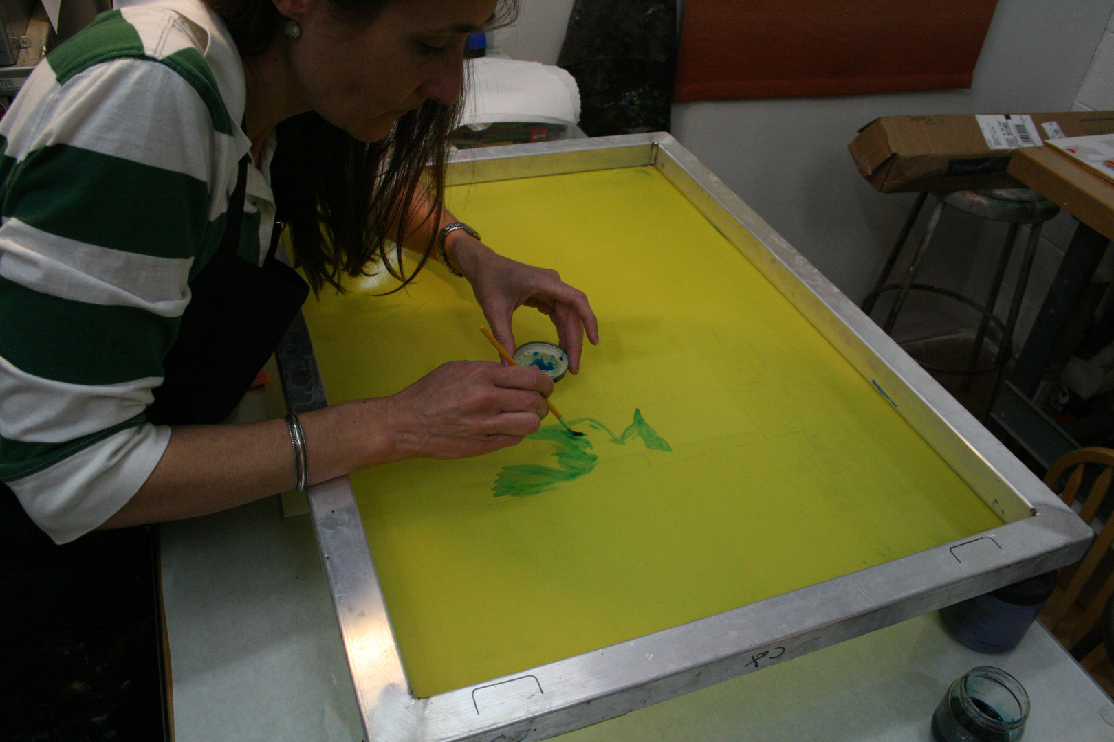 The screen mesh can be painted with water soluble paints